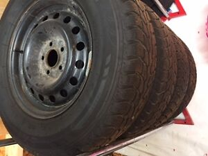 Like New Winter Claw Snow Tires with Rims (off Ford Escape)