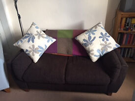 Comfortable brown two seater sofa