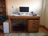 Heals pine office desk and matching three drawer filing cabinet on castors, fits under desk.