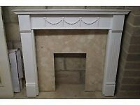 White MDF mantle piece and marble fire surround.