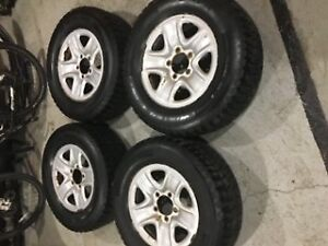 Winter studded tires on rim for sale