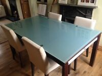 Ligne Roset mahogany and glass dining table and four chairs