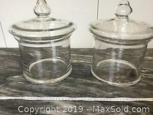 Pair of large glass apothecary jars with lids
