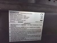 A Black & Silver Kenwood Microwave for sale