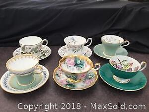 Assortment Of Tea Cups W Green Theme