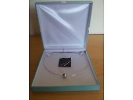 Brand new platinum clad pendant with sterling silver necklace in gift box