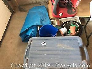 Tarp Lidded Storage Bin and Garden Supplies B