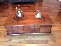 Solid wood coffee table, 12 small drawers and storage area.