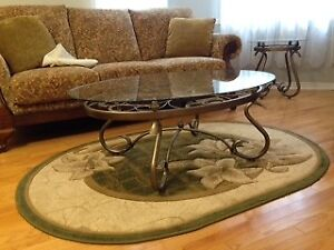 Glass coffee table with metal legs and matching side table