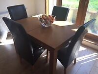 light oak dining room table and 6 chairs