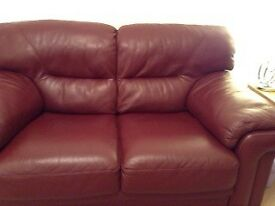 Two x two seater Real Leather Sofas - Wine Colour