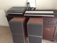 Bang & Olufsen stero system. Record deck. Amp. Speakers. Headphones. Remote control.