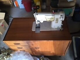 Singer Sewing Machine in a fitted unit