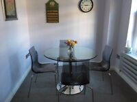 Glass dining table /four chairs: excellent condition