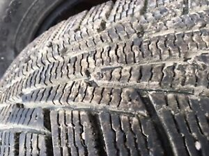 "4 15"" winter tires 195/60R15 - 2 studded lots of tread left"