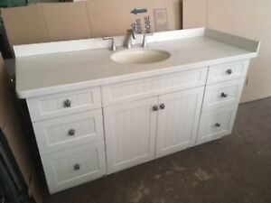 Vanity with Sink and Corian Countertop