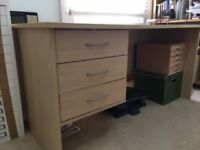 Large Staples desk with 3 drawers. Good condition