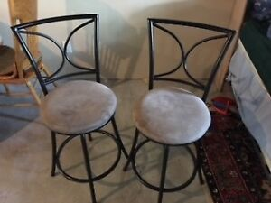 2 Bar stool chairs swivel in good shape. only $30.00.