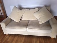 2 Seater Sofa in Beige/Gold material, Good Condition, Washable covers