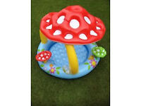 Baby paddling / ball pool with inflatable floats.