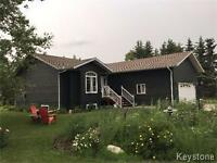 Lovely open concept 3 bedroom home in a private setting