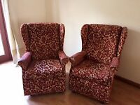 2x red arm chairs