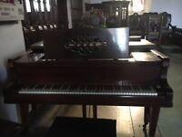 Leutke mahagany baby grand piano.
