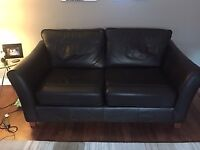 Two dark brown leather sofas from M+S