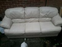 Cream leather three seater sofa in very good condition
