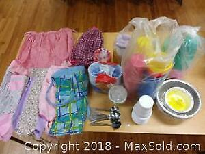 Vintage aprons and plastic glasses and pans