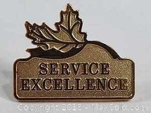 Service Excellence With Maple Leaf Gold Toned