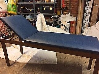 Wooden framed massage plinth with adjustable back rest
