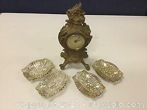 An Antique American Metal Mantle Clock And More