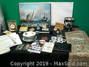 Variety of items, saucers, books, WWF cards, nickles etc