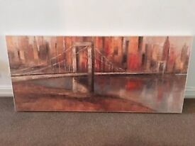 Painting on canvas of a skyline in warm reds and neutrals. Easy on the eye. Ready to hang.