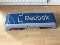Reebok Fitness step in good condition, barely used. Has adjustable height settings.