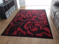 Brand new black and red area rug