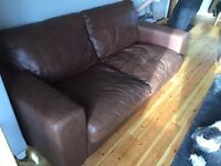 2 brown leather sofas for sale (1x3 seater, 1x2 seater) good condition