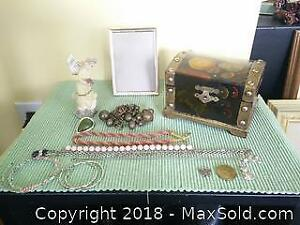 Jewelry box with assortment of items