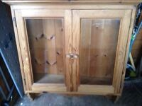 antique pine double cupboard, joinery with sculptured shelf.
