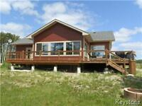 Lakefront! Lake access! Lake view! Exquisite 2 BR home