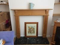 Fire surround and black marble hearth
