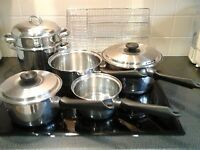 Selection of saucepans and a drawer divider for cutlery