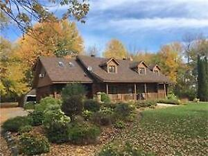 SPECTACULAR LOG HOME ON 2.3 ACRE TREED LOT (Long Sault, Ont)