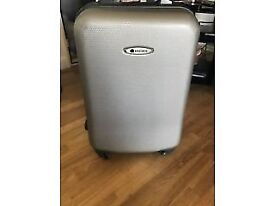 DELSEY SILLVER HARDSHELL 4 WHEEL TROLLEY SUITCASE