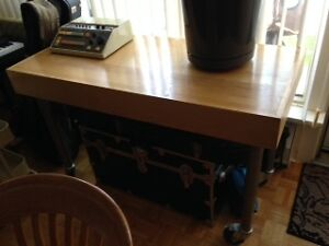 Wooden table with adjustable metal legs