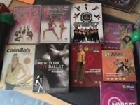 8 exercise DVDs and dumbbells