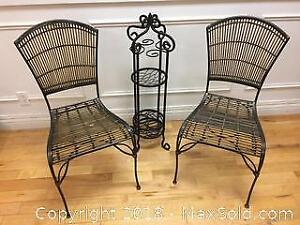 Elegant metal dining chairs with side plant stand