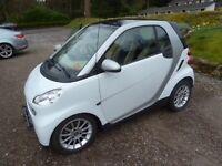Smart car with A-frame for towing behind camper vans etc