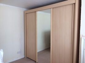 Very large wardrobe with 3 sliding doors and full height mirror